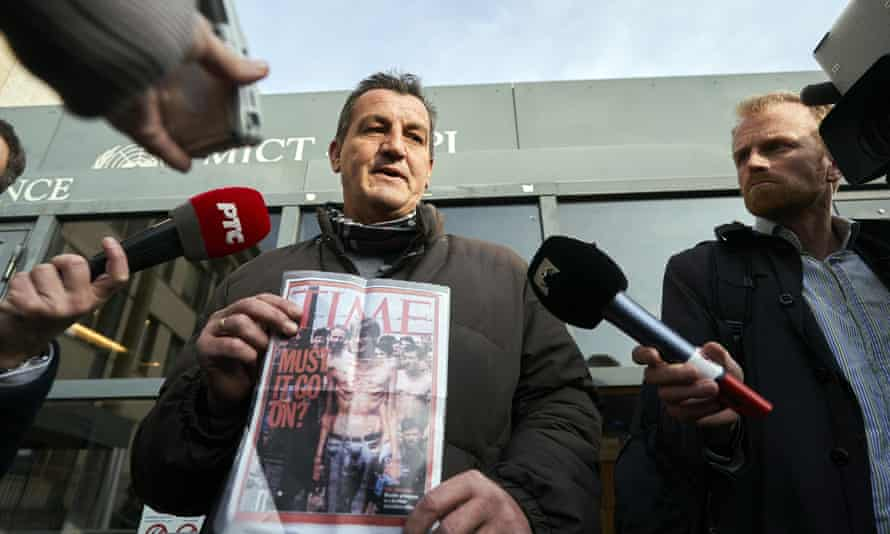 Fikret Alic holds a copy of Time magazine which featured his emaciated image on its cover in 1992. He was outside court when Mladic was sentenced to life in prison for atrocities perpetrated during Bosnia's 1992-1995 war
