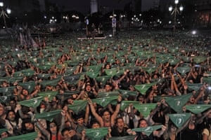 Thousands of women wave their green scarves during a rally to demand the legalisation of abortion in Buenos Aires, Argentina