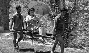 Mrs Caresse Crosby takes a luxury ride around the grounds of Roccasinibalda, her vast estate just outside Rome in 1964.