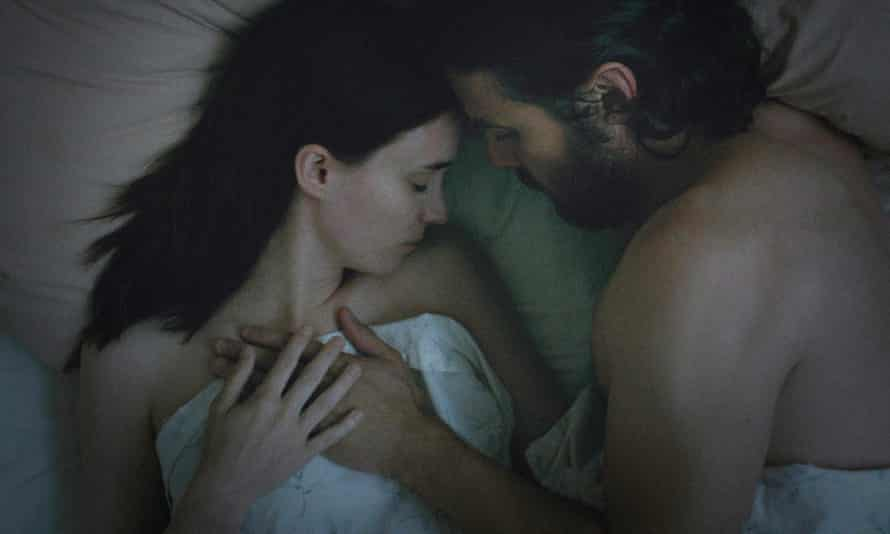 """'With only the faintest bit of explanation coming from another sheet-wearing ghost waving """"hello"""" from a house across the way, we realize we're stuck in this spot until something happens' … Rooney Mara and Casey Affleck in A Ghost Story."""