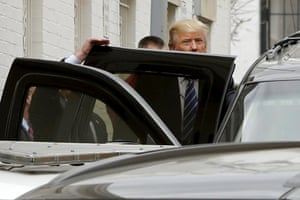 Trump departs through a back door after meetings at Republican National Committee headquarters in Washington.