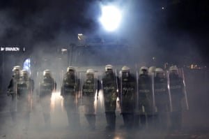 Riot police stand in a row during a protest in Tirana, Albania