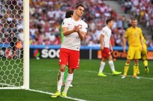 Arkadiusz Milik reacts after missing a good chance.