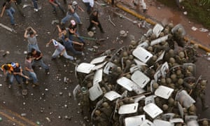 Supporters of ousted Honduras president Manuel Zelaya clash with soldiers near the presidential residency in Tegucigalpa on 29 June 2009.