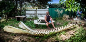Buck Cullen with his daughter Kaiarahi (10 months) in his back yard where he is storing a pair of massive Sperm Whale jawbones. Buck is a integral member of the whale recovery team, alongside Hori Parata.