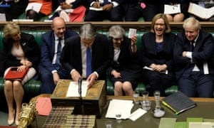 Philip Hammond being given some cough sweets by Theresa May as he delivers his Budget on Wednesday.