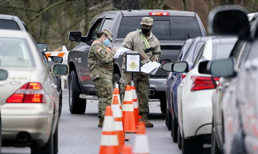 National guard personnel check in people as they wait to receive a Covid vaccination on 26 February 2021, in Shelbyville, Tennessee.