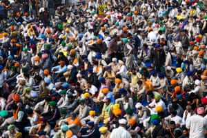 Farmers take part in a demonstration at the Delhi-Haryana state border at Singhu on 4 December