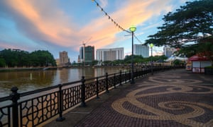Kuching city waterfront at sunset.