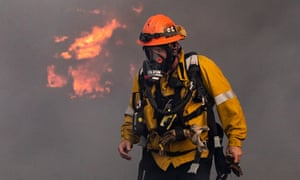 A firefighter works to extinguish the Tick fire in a factory near Santa Clarita, California, 24 October 2019.