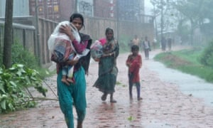 People look for shelter during the cyclone Roanu in Chittagong, Bangladesh