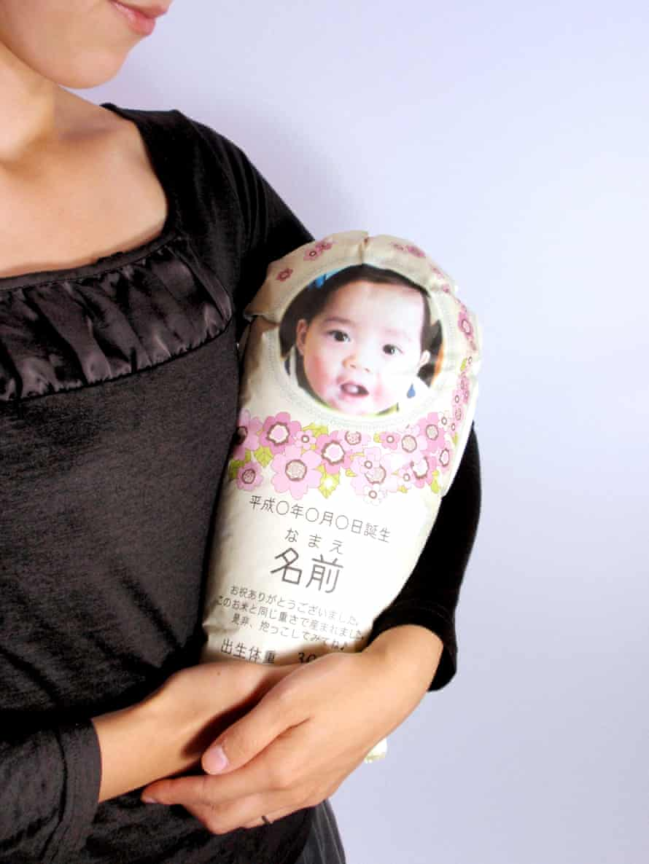 Woman cradling rice baby.
