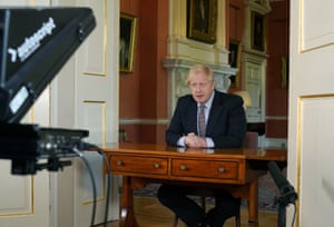 Boris Johnson addresses the nation from behind a back-to-front desk wedged into a Downing Street doorframe, 10 May 2020.
