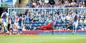Benik Afobe scores Wolves' opener at Blackburn.