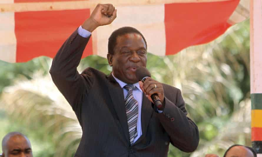 Emmerson Mnangagwa greets party supporters at the ZANU-PF headquarters in Harare
