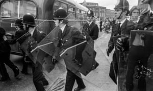 For the first time outside Northen Ireland, the police were equipped with heavy duty plastic riot shields