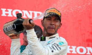 British Formula One driver Lewis Hamilton of Mercedes AMG GP sprays Champagne on the podium after the Japanese Formula One Grand Prix at the Suzuka Circuit in Suzuka, central Japan, 07 October 2018