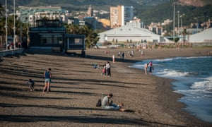 Children and parents enjoy Misericordia beach in Malaga, Spain.