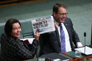 The member for Brand, Madeleine King, holds up a newspaper before question time in the House of Representatives in Parliament House