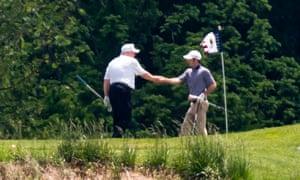 Donald Trump golfs.