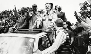 Pik Botha, standing right, attends a rally in 1994 with Mangosuthu Buthelezi and Nelson Mandela.