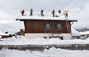 Krün, GermanyFirefighters remove snow from a rooftop in the small Bavarian village of Krün near Garmisch-Partenkirchen.