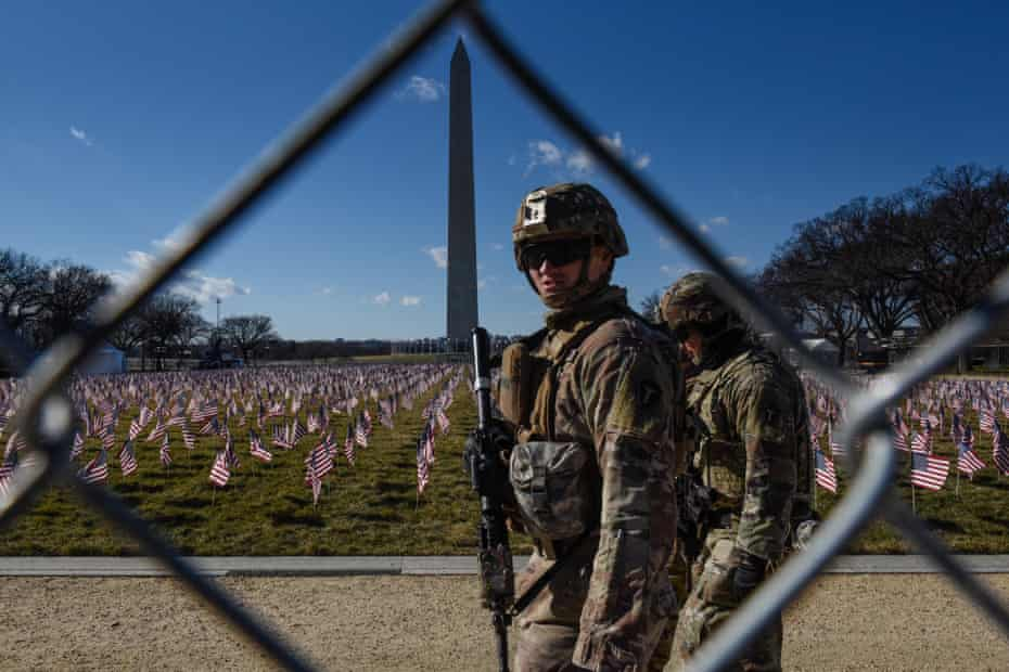 National Guard members patrol the National Mall in Washington DC.