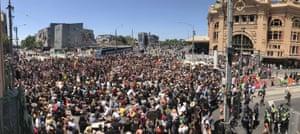 Protesters gather at Flinders Street Station in Melbourne