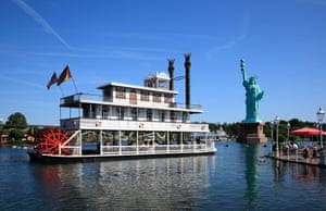 A statue in a theme park in Lower Saxony, Germany, is flanked by a model steamboat