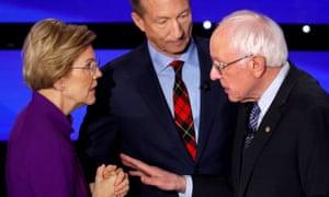 Elizabeth Warren speaks with Bernie Sanders as billionaire activist Tom Steyer listens after the debate on Tuesday.