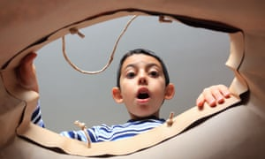 Child opens present and looks shocked