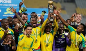 Players from South Africa's Mamelodi Sundowns team celebrate after winning the African Champions League title.