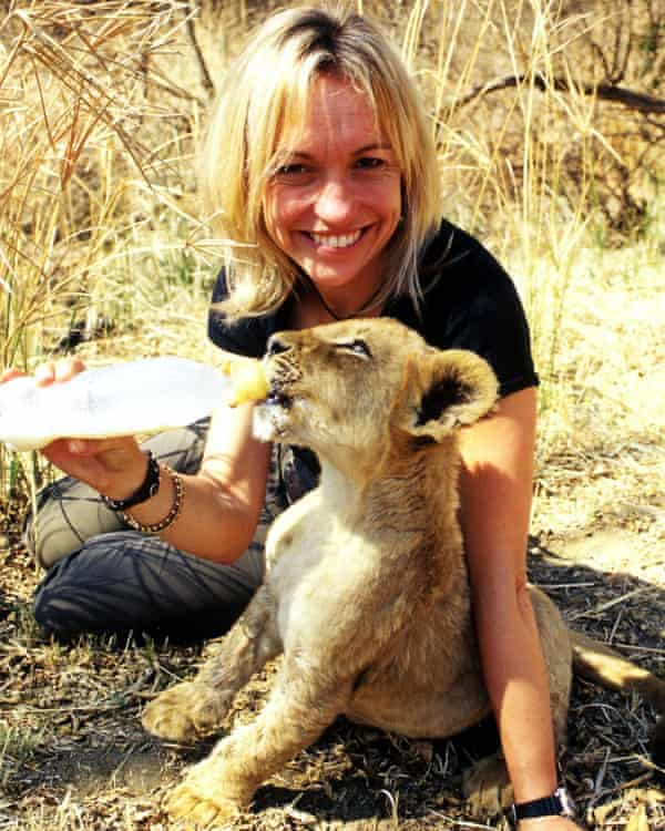 Michaela Strachan, feeds a lion cub for The Really Wild Show Pride Special in 2004, in South Africa.