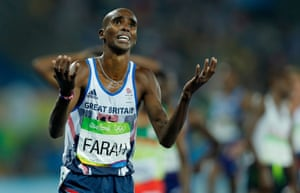 Mo Farah celebrates victory in the men's 5000m final and looks to the skies as he completes his dream of one medal for each of his children