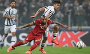 Arturo Vidal of Bayern Muenchen and Paulo Dybala of Juventus battle for the ball.