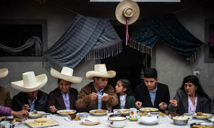 Pedro Castillo, center, participates in a breakfast with his family that is open to the press at his house in Chugur, Cajamarca region, on 6 June.
