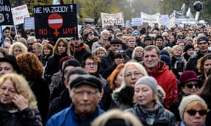 People march during a protest against plans to tighten abortion laws in Warsaw on Sunday.