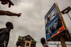 A broken billboard showing the face of President Kabila