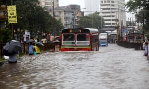 Heavy rain and flooded streets bring Mumbai to a virtual standstill.