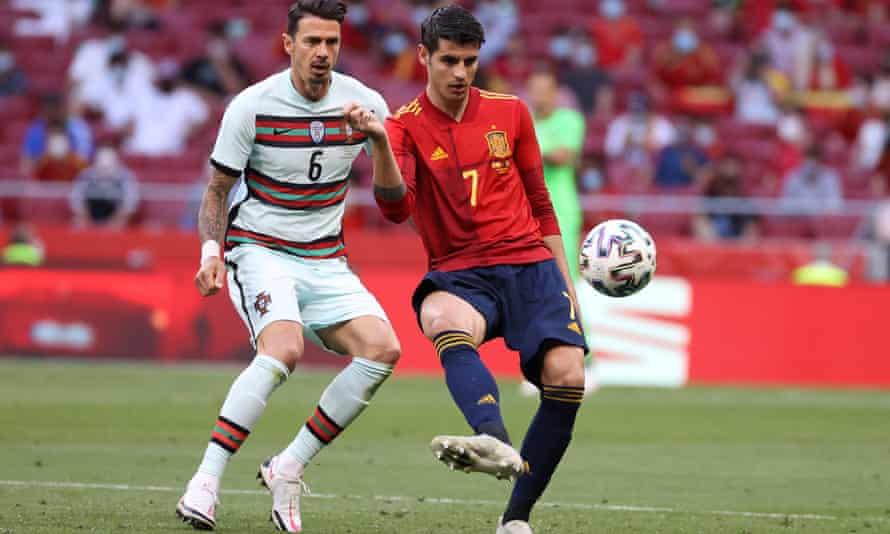 Spain's striker Álvaro Morata in action against Portugal's defender José Fonte