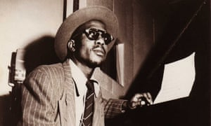 thelonious monk seated at a piano in about 1950