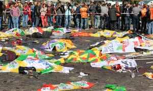 Bodies of victims of Saturday's bomb blasts in Ankara are covered with flags and banners