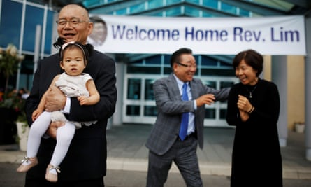 Pastor Hyeon Soo Lim, who returned to Canada from North Korea on 9 August, holds his granddaughter as he leaves the Light Presbyterian Church in Mississauga.