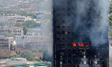 Flames and smoke engulf Grenfell Tower in west London