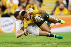Israel Folau is tackled by England's Owen Farrell.