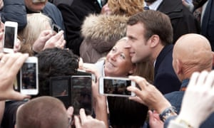 Macron poses with supporters in Le Touquet.