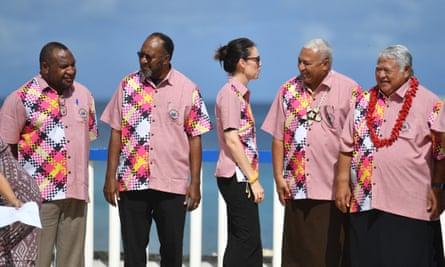 The leaders of Papua New Guinea, Vanuatu, New Zealand, Fiji and Samoa talk before the group photo at the Pacific Island Forum.