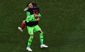 A relieved Luka Modric celebrates with Danijel Subasic after Croatia scrape past Denmark on penalties.