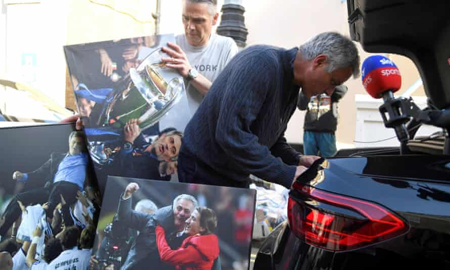 José Mourinho with photographs of his achievements in Football.