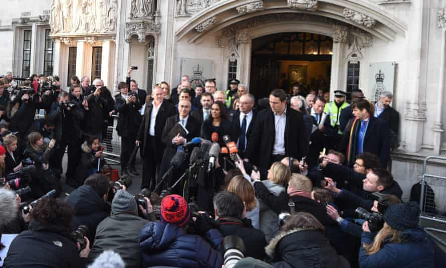 Gina Miller (centre background) delivers a statement outside the supreme court.